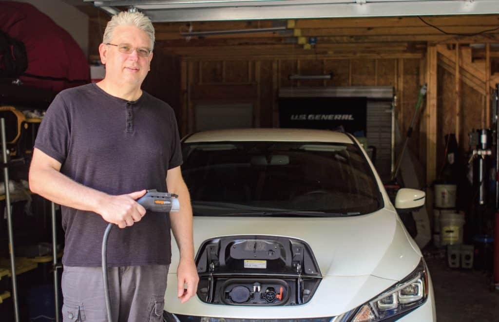 Nigel Kingswood washing his electric car