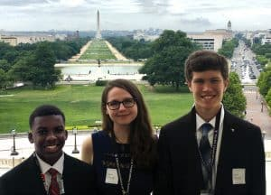 Three Youth Tour Students with The Washington Monument in the background