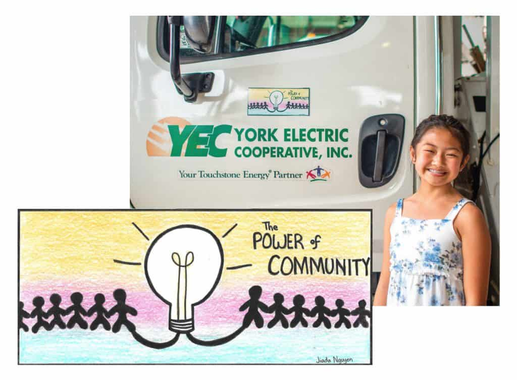 Jiada Nguyen standing by a YEC utility truck