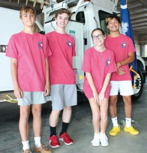 Virtual Youth Experience participants posing by YEC truck.