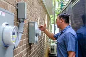 YEC's Brent Clinton looking at an electricity meter