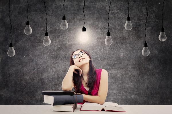 Studious student imagining bright ideas.