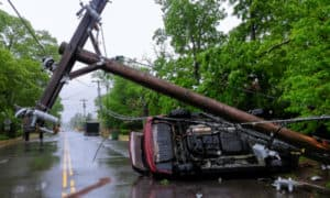 Car accident after a severe storm with crash electric pole