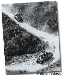 American- and Chinese-manned M4 Sherman tanks travel on the Burma Road, circa 1945.