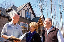 YEC's Tim Scism meets with Nancy and Tracey Bridges of Aspen Homes at a house they're building.