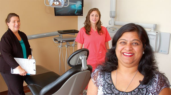 Dr. Anjali Seth with her receptionist, Dian Helms (left), and assistant, Amber Johnson, at Carolina Smile Dentistry LLC in Indian Land. Use your Co-op Connections card to receive Healthy Savings Discounts on services there through the Humana Dental Access Network.