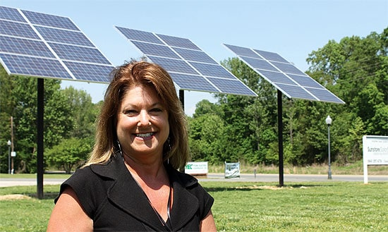 Donna Dessaint, a YEC member services representative, in front of the solar array at the co-op's Fort Mill office. Dessaint is the point person for the co-op's new solar programs. Photo: Joyce Baker