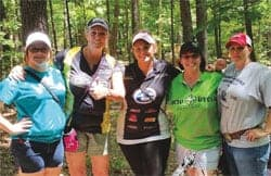 Freeman (center) with pro Connie Griffin (second from left) and teammates at the Augusta Pro/Am.