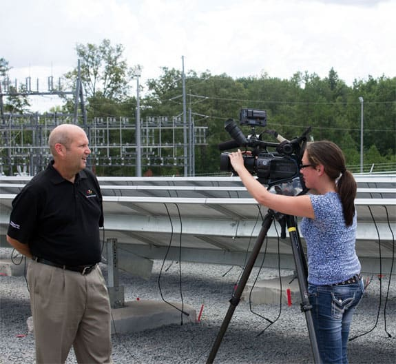 YEC's Marc Howie with CN2 reporter, Mia Macy