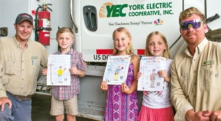 YEC Linemen with the three safety coloring page contest winners.