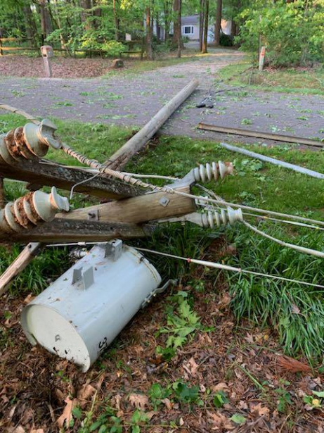 Broken electric pole wires and transformer on the ground
