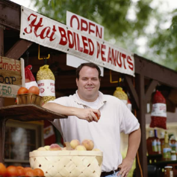 Small business owner at fruit & vegetable stand