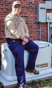 Oliver Dowdle sitting on Generac generator