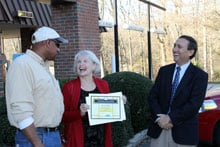 Mrs. Claudia Mady from Fort Mill. YEC employees Vic Wilform (left) and Paul Basha (right)