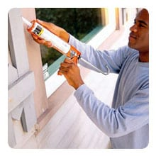 Caulk along windows with a clear sealant.