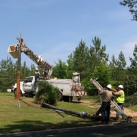 Crew members working with downed power lines