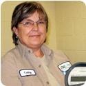 YEC Engineer, Cathy Heffner with electric meter